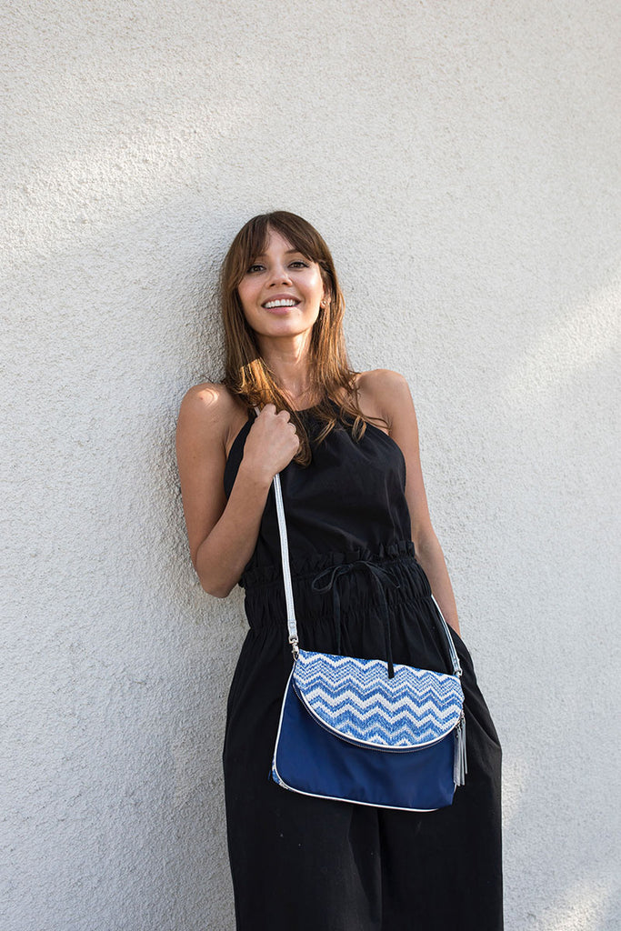 Woman with a blue cross bag