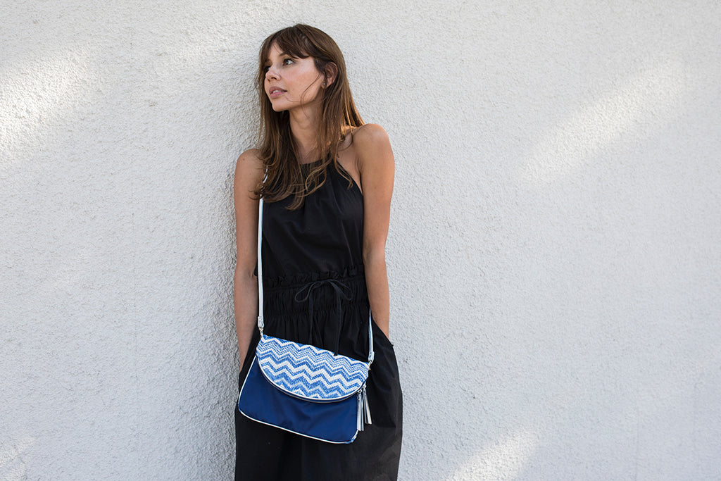 Woman with a nylon crossbody bag