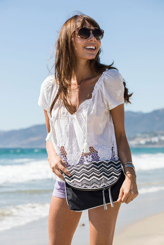 woman at the beach with her crossbody bag