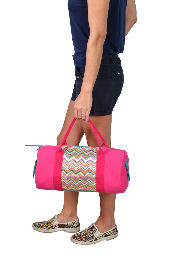 women carrying a pink makaron duffle bag