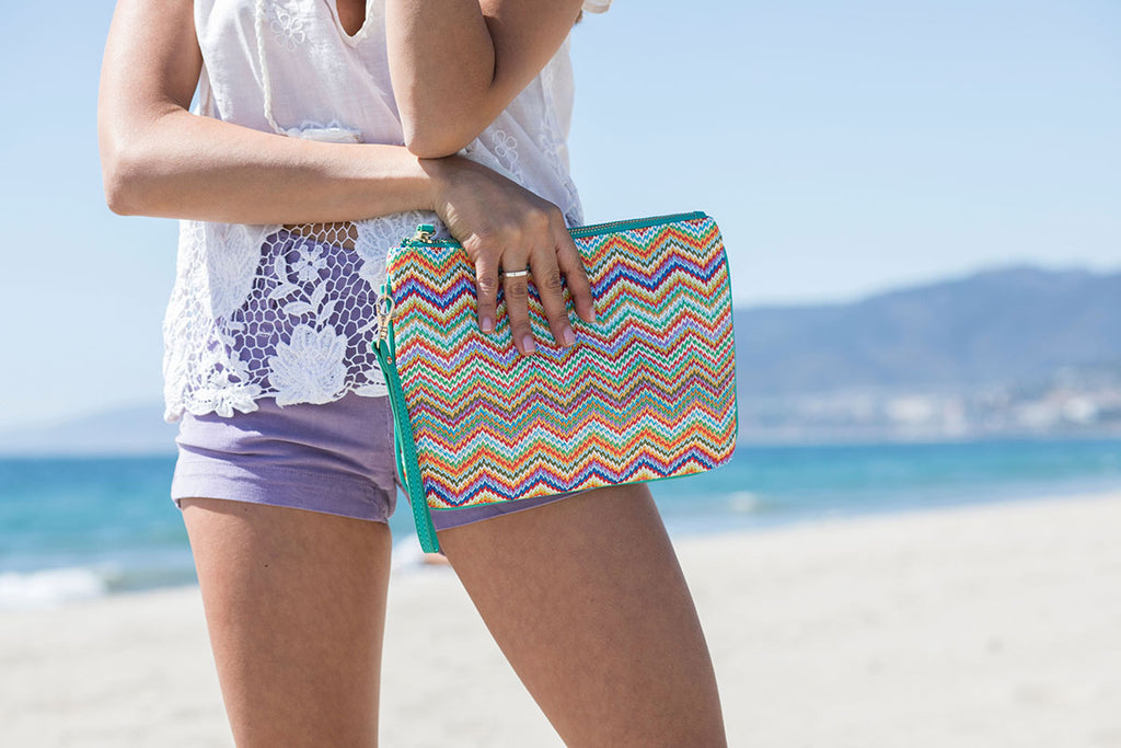 Girl at the beach with Makaron's pouch