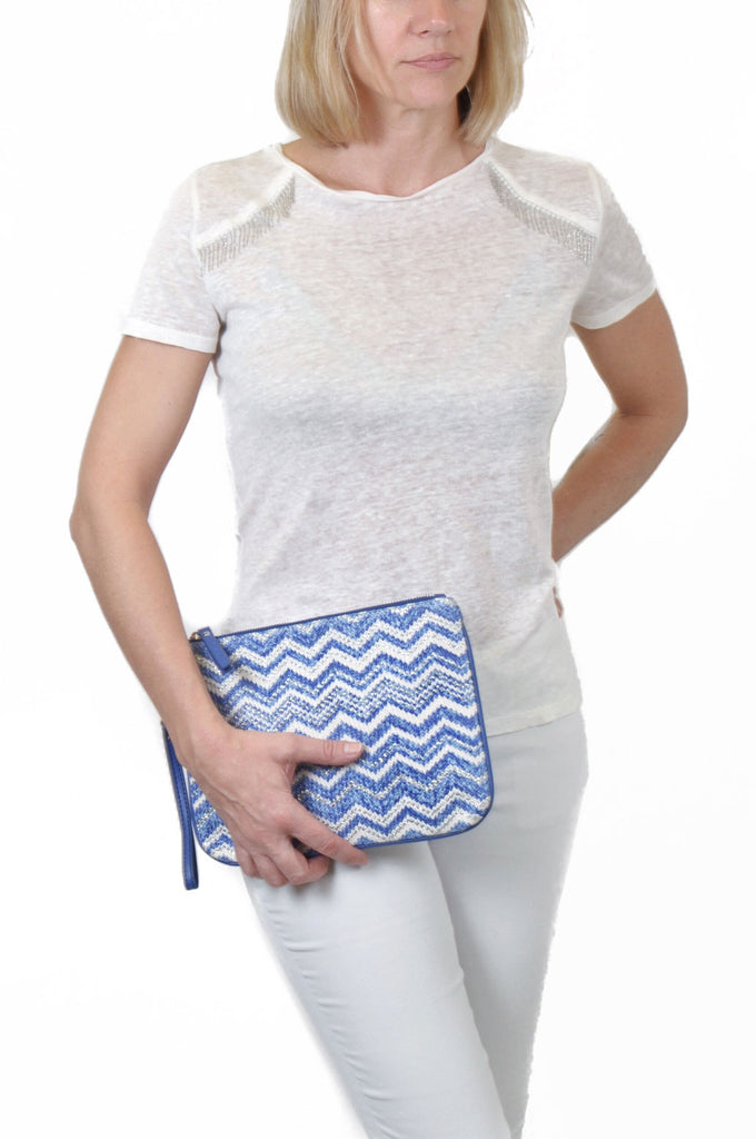 woman wearing a blue designer makeup bag by Makaron