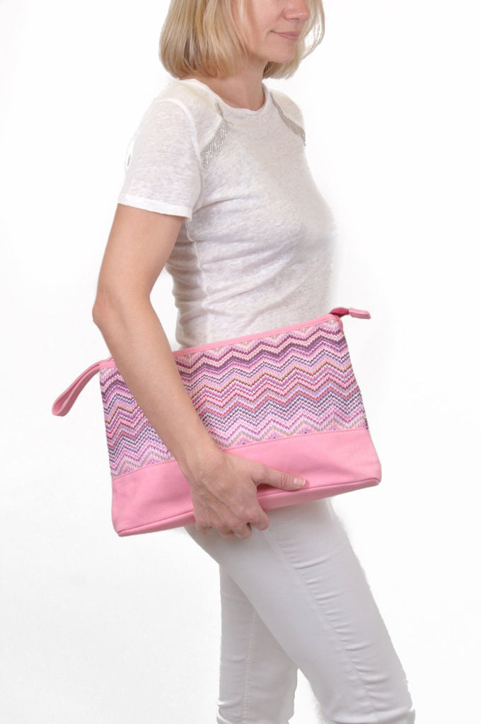woman wearing a pink travel makeup bag