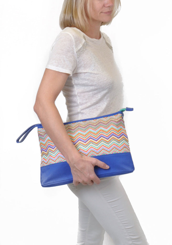 woman carrying designer makeup bag
