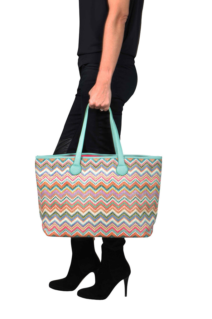 woman wearing a travel tote bag