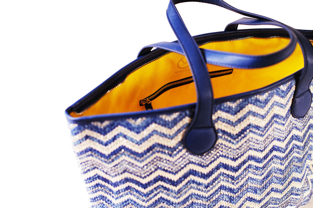 blue silver tote bag with yellow canvas lining and pockets