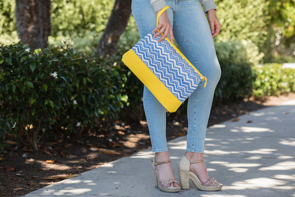blue zigzag nylon cosmetic pouch with yellow canvas