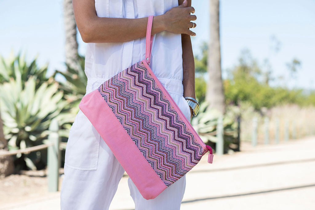 model carrying a pink cosmetic travel bag