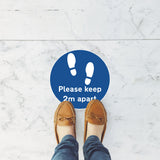 customer standing on a Please keep 2m apart blue Floor Sticker