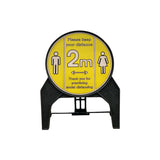 """Please keep your distance 2m"" Circle Freestanding Sign front view."