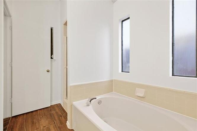 re-combine shower and tub in master bath