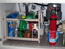 Load image into Gallery viewer, Kitchen our under sink storage shelf creates organization space can custom fit both height and width goes around pipes and gets you organized