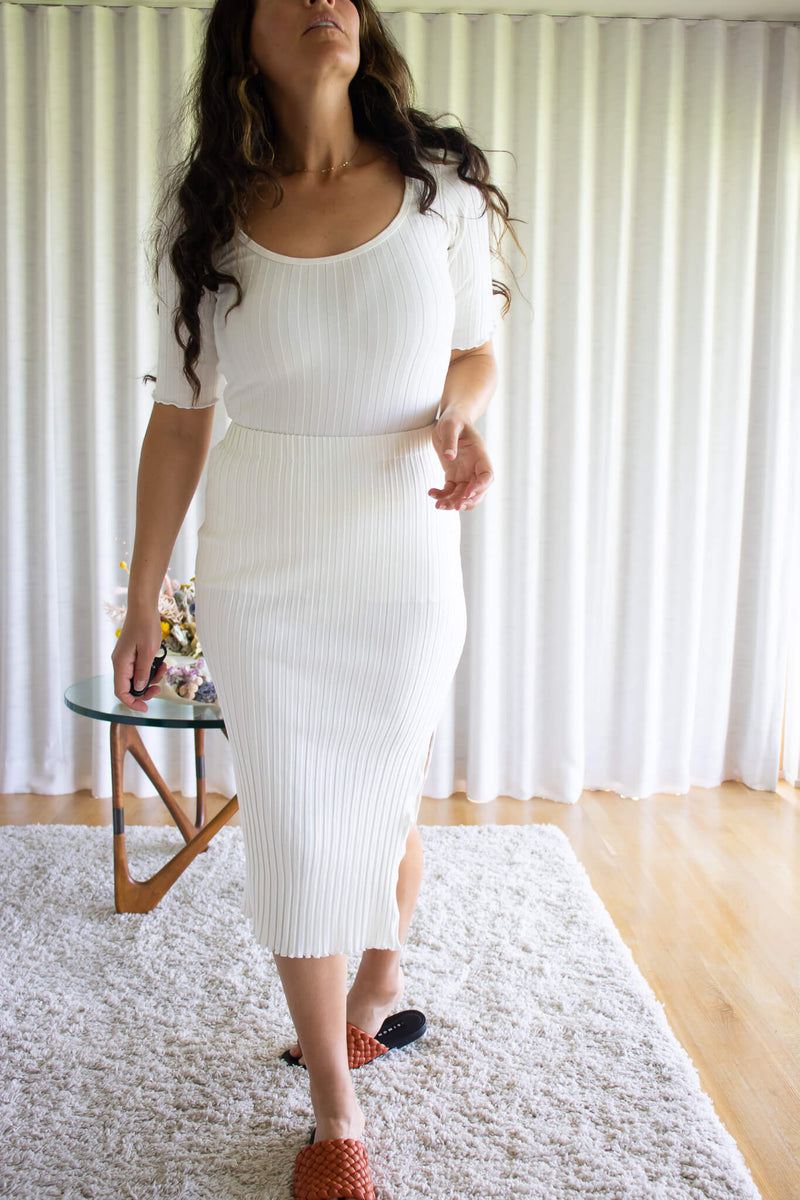 A-white-tight-midi-length-ribbed-skirt-with-side-slit-paired-with-simon-miller-rib-top-and-curated-at-Jake-and-Jones-Santa-Barbara-Boutique-for-Emerging-Designer-Fashion