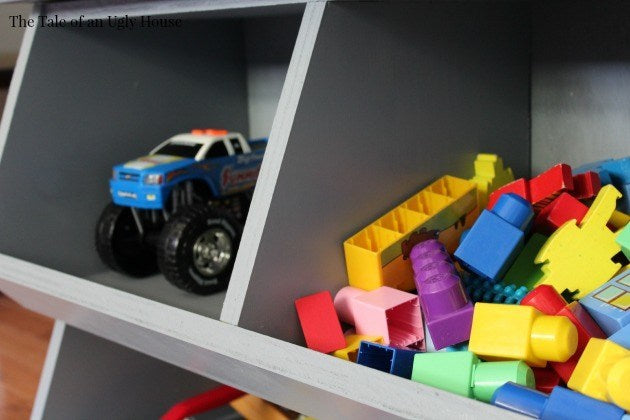 Build a cubby storage toy organizer from just one sheet of plywood! This DIY stacked toy cubby with dividers is perfect storage for toys, craft supplies, or whatever you need to organize in a child's room, play room, or nursery.  Our entry table...