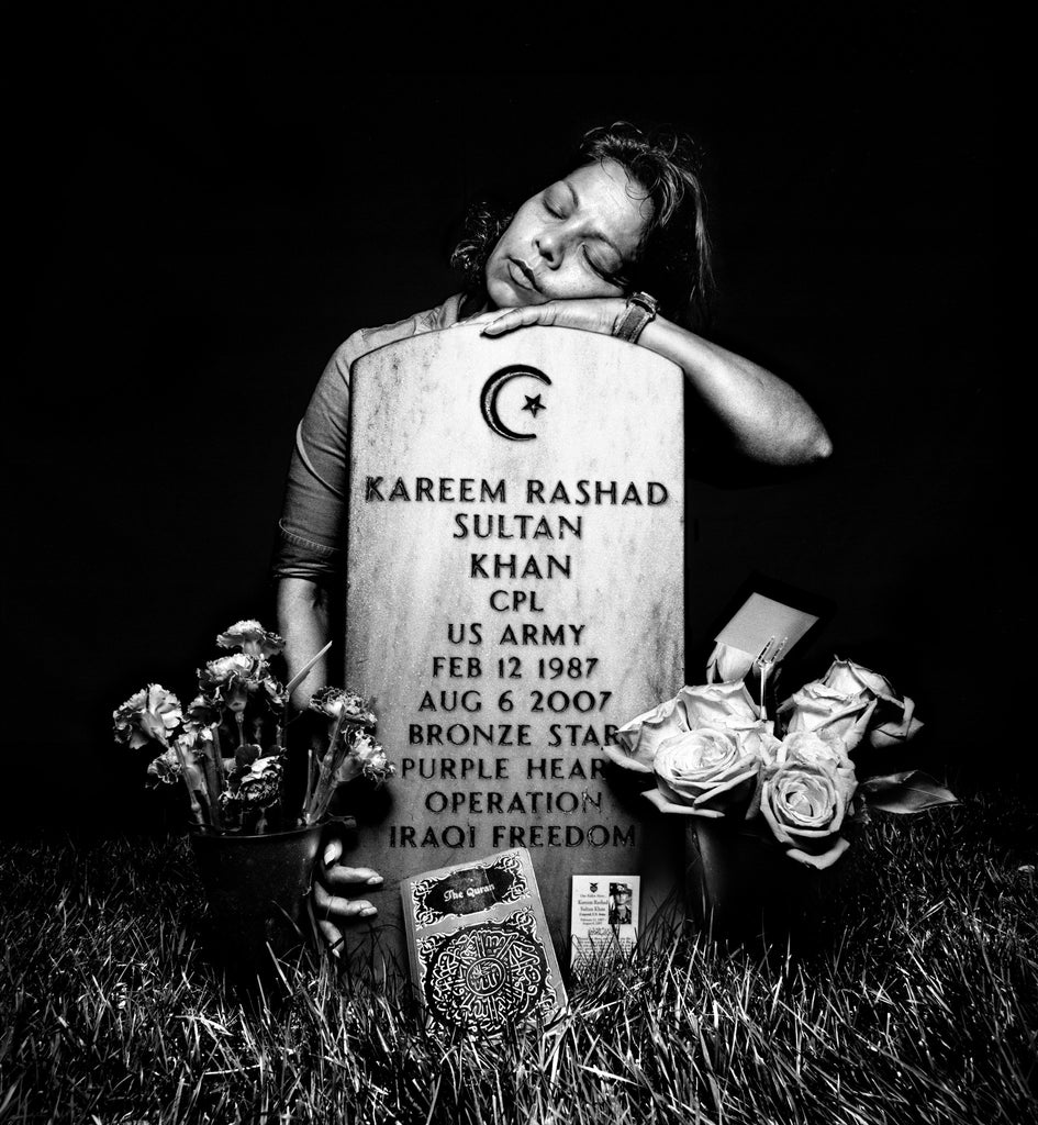 SERVICE: Elsheba Khan at the grave of her son, Specialist Kareem Rashad Sultan Khan. Arlington National Cemetery, 2008.