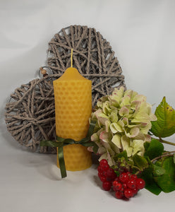 Hand-poured natural beeswax candle with honeycomb design