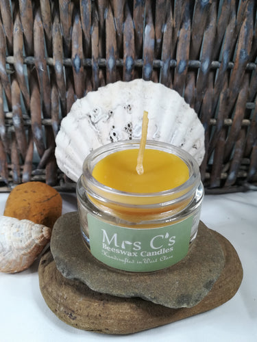 Hand-poured beeswax candle in a glass jar