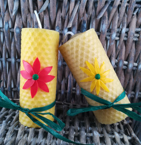 Rolled natural beeswax candle with flower deco