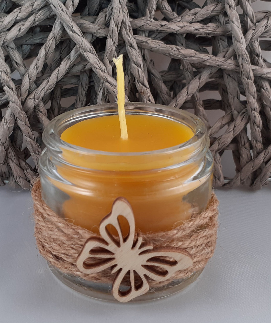 Glass jar beeswax candle with cord and butterfly decoration