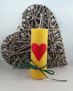 Natural beeswax candle with red heart