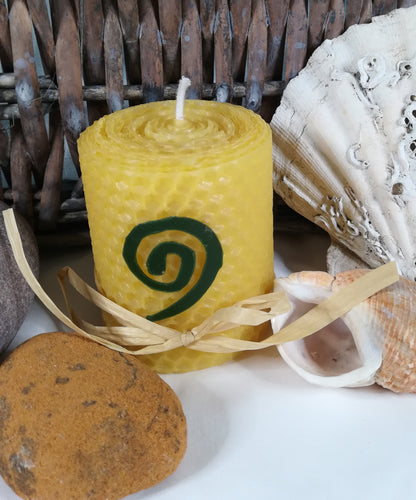 Hand-Rolled natural beeswax candle with Celtic Spiral design
