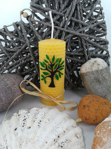 Hand-rolled natural beeswax candle with tree design