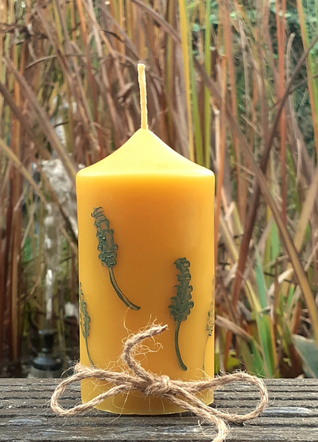 Beeswax candle with leaf decor