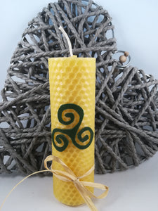 Hand-rolled natural beeswax candle with Triple Spiral design