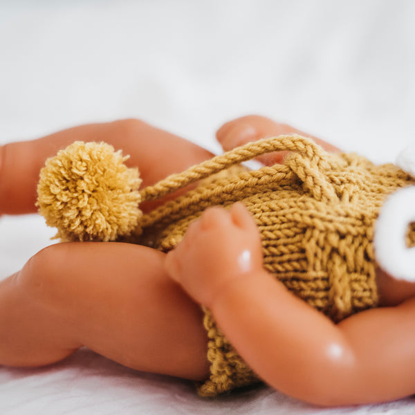 Knit Unisex Romper with Pom Pom Ties (32cm Miniland)