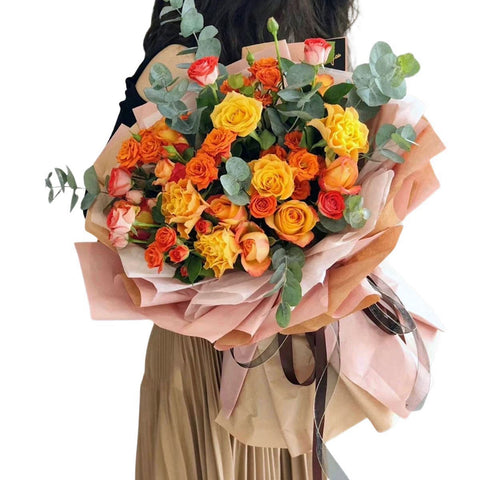 A bouquet of orange and yellow roses