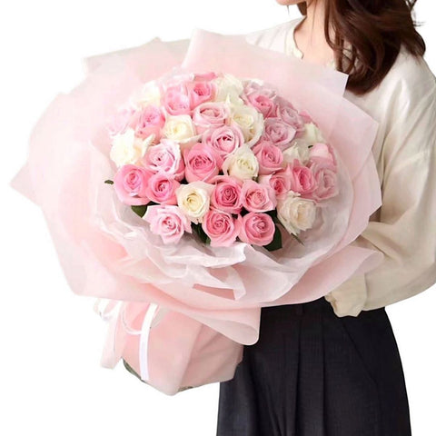 A bouquet of pink and white roses