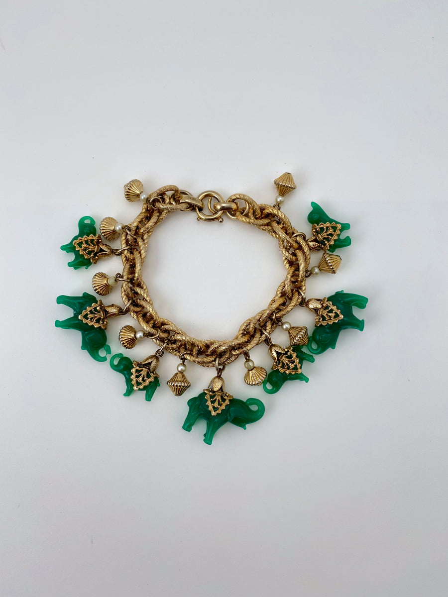 1950S NAPIER GREEN GLASS ELEPHANT BRACELET