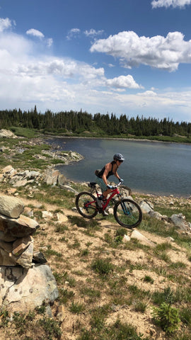 mountain biking mama - knowing her goat