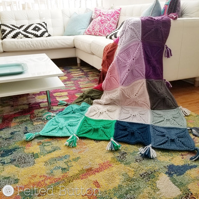 Large colorful crochet textured granny squares in blanket draped on couch, free crochet afghan pattern, asanas blanket by Susan Carlson of Felted Button colorful crochet patterns
