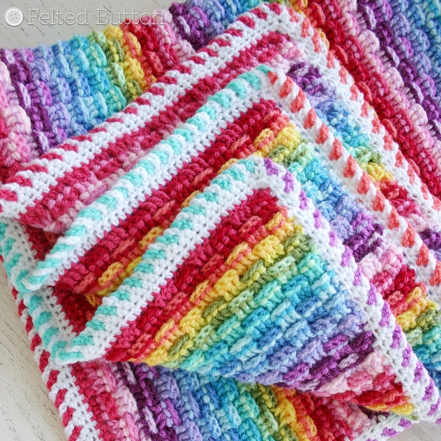 Basket of Rainbows Blanket, crochet rainbow baby blanket or throw in basketweave stitch pattern with multicolored border by Susan Carlson of Felted Button | Colorful Crochet Patterns