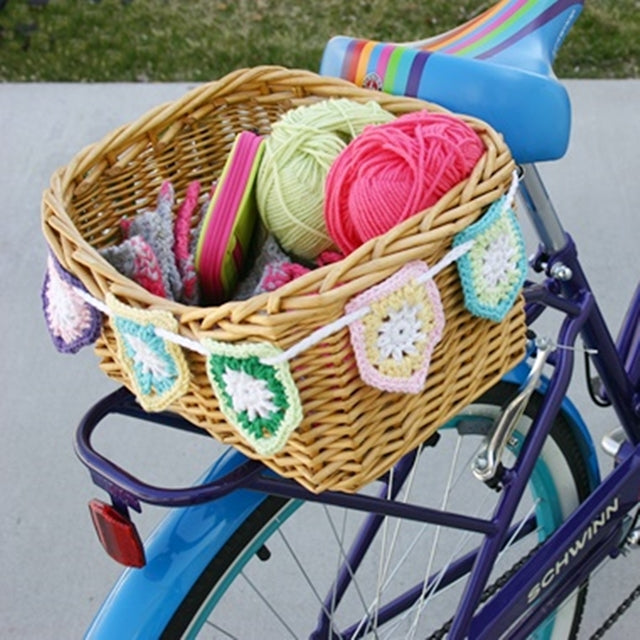 Colorful pentagon cotton flag bunting hanging on bike basket, free crochet pattern by Susan Carlson of Felted Button | Colorful Crochet Patterns