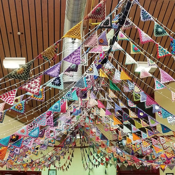 Bunting crochet flags at Yarndale in Skipton, colorful Garland triangles hanging