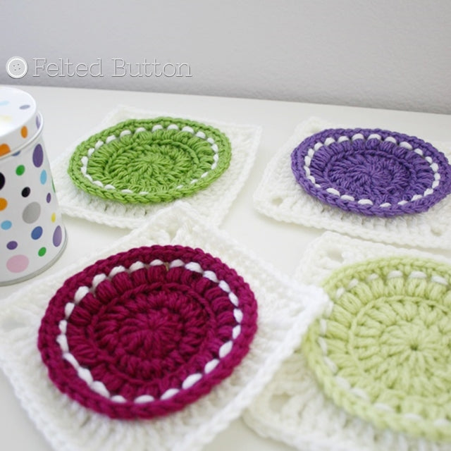 Large buttons in square crochet motifs in purple, blue and greens, Bright as a Button crochet pattern by Susan Carlson of Felted Button | Colorful Crochet Patterns