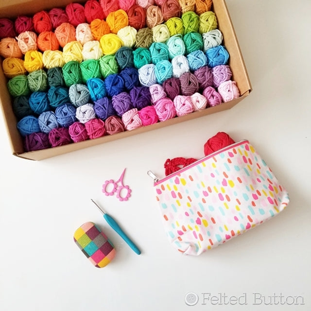 Scheepjes Cahlista colorful cotton yarn pack with 84 rainbow colors in bin, with crochet hook, scissors and project pouch, yarn review by  by Susan Carlson of Felted Button colorful crochet patterns