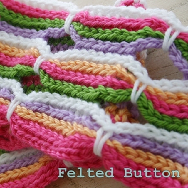 Pink, green, orange and white striped Candy Stick Blanket crochet baby blanket designed by Susan Carlson of Felted Button | Colorful Crochet Patterns