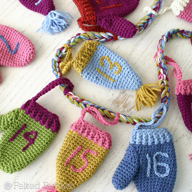 Cozy Christmas Countdown hanging advent calendar of mini crochet mittens and hats with poms, crochet pattern by Susan Carlson of Felted Button | Colorful Crochet Patterns