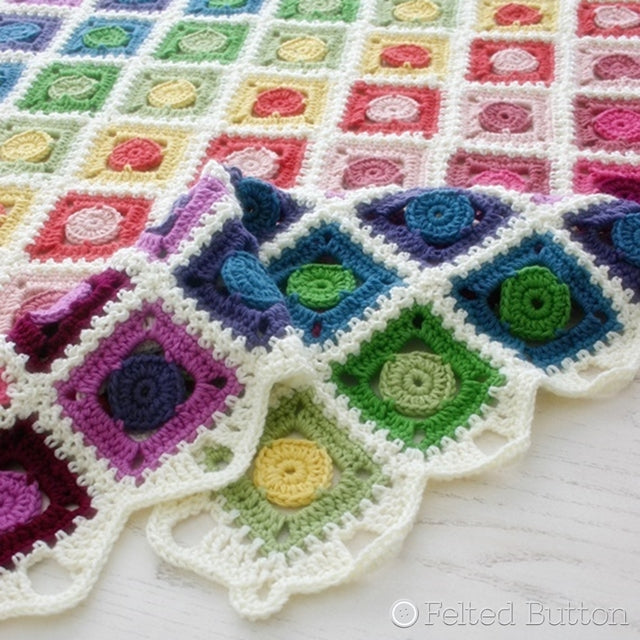 Rainbow granny square blanket with circle centers, Circle Takes the Square Blanket, crochet afghan pattern by Susan Carlson of Felted Button | Colorful Crochet Patterns, Knit Picks Comfy yarn