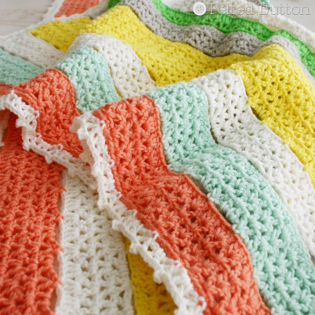 Orange, geen, yellow and white crochet blanket in stripes, Citrus Stripe Blanket for babies, afghan by Susan Carlson of Felted Button | Colorful Crochet Patterns