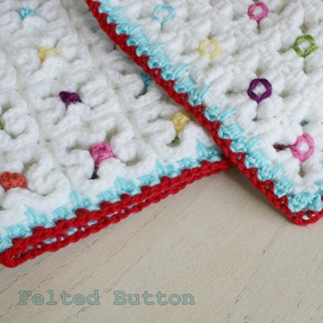 Crazy Good Mat and Blanket, colorful rainbow dots in center of wavy crochet flower grid, by Susan Carlson of Felted Button | Colorful Crochet Patterns