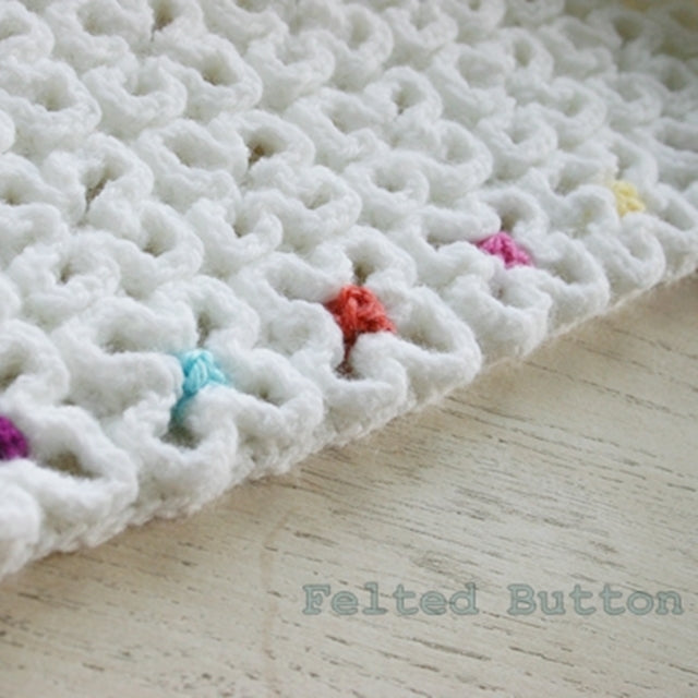 Colorful dots in center of wavy crochet blanket or mat, Crazy Good Mat by Susan Carlson of Felted Button | Colorful Crochet Patterns