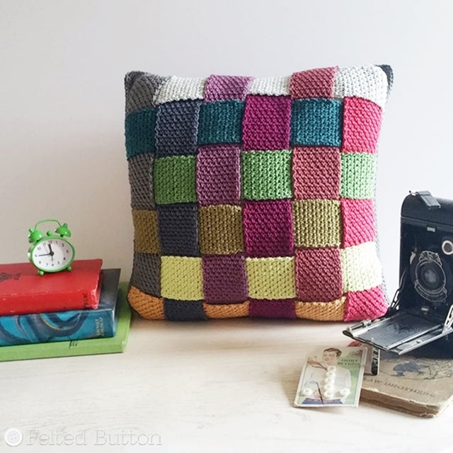 Crisscross Cushion Cover crochet pattern using Scheepjes Catona, styled with vintage camera, books and wee clock, free crochet pattern by Susan Carlson | Felted Button | Colorful Crochet Patterns