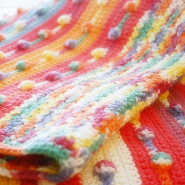 Cotton bobble blanket in orange, green and blue with rainbow bobbles, Susan Carlson of Felted Button | Colorful Crochet Patterns