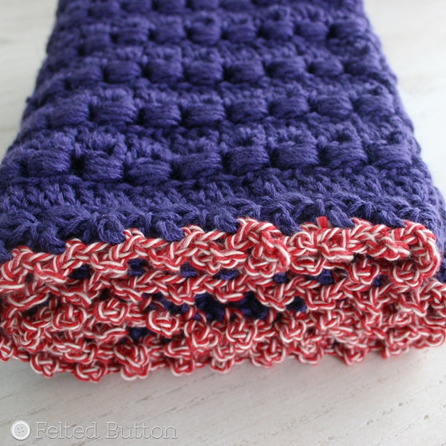 Purple textured crochet cowl with red border, Cwtch Cowl and Hood, crochet pattern by Susan Carlson of Felted Button | Colorful Crochet Patterns