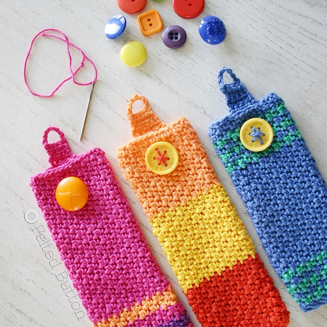 Bright crochet colorful eyeglass pouches with button closures, free crochet pattern by Susan Carlson of Felted Button colorful crochet patterns