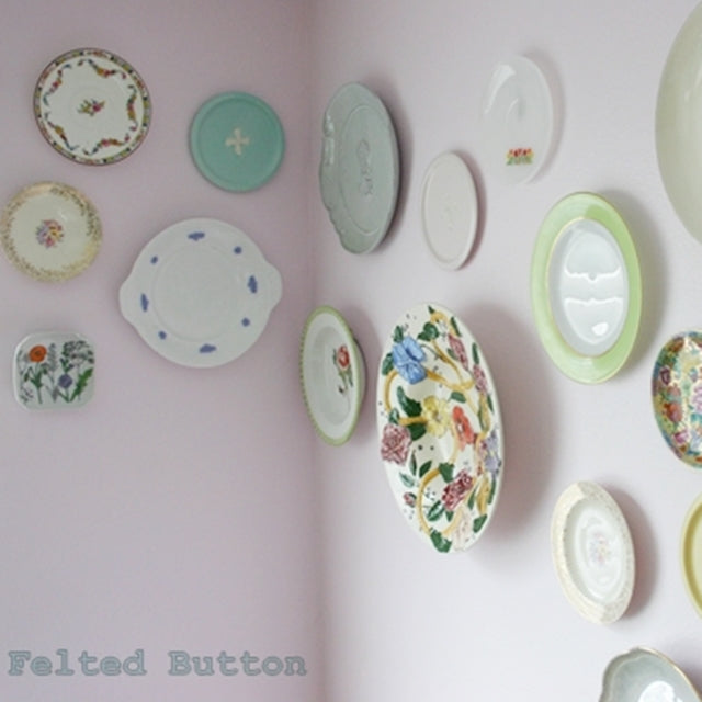 Vintage and colorful plates hanging on pink wall, by Susan Carlson of Felted Button | Colorful Crochet Patterns